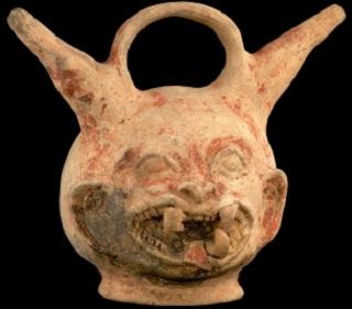 Alcarraza o recipiente de doble vertedera con el retrato de un felino. Tumaco, período Inguapí, 500 a.C. a 300 d.C. Colección Museo del Oro, Banco de la República. C02702